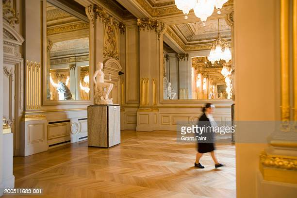 france, paris, female security personnel walking through musee d'orsay - musee d'orsay stock pictures, royalty-free photos & images