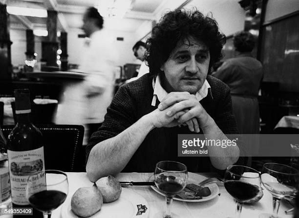 France Paris Italian artist Bruno Bruni dining in an restaurant