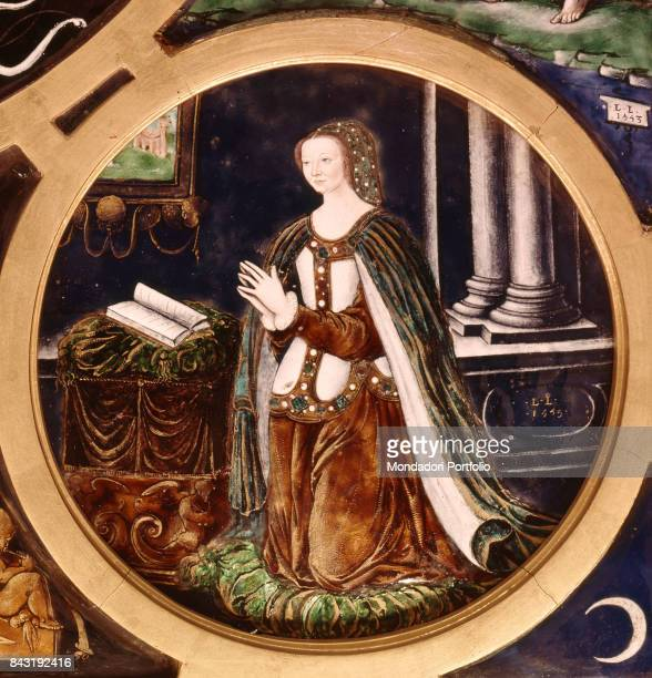 France, Paris, Louvre museum. Detail. Portrait of the Queen and Henry II D'Orleans' wife Catherine de' Medici of France kneeling for praying.