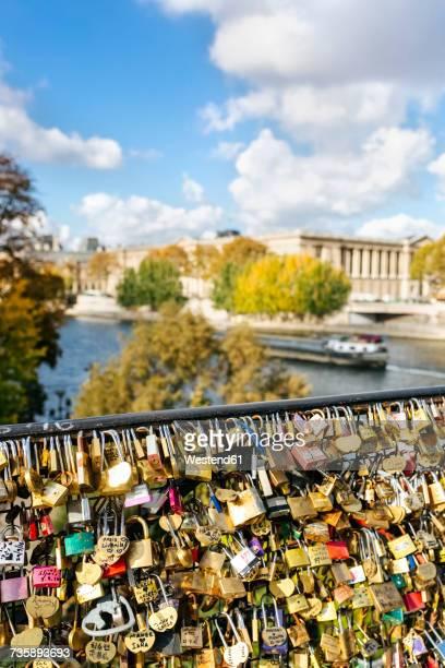 France, Paris, love locks at railing of a bridge over Seine River