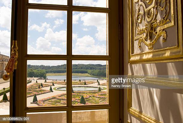 france, paris, palace of versailles, gardens seen through window - chateau de versailles stock pictures, royalty-free photos & images