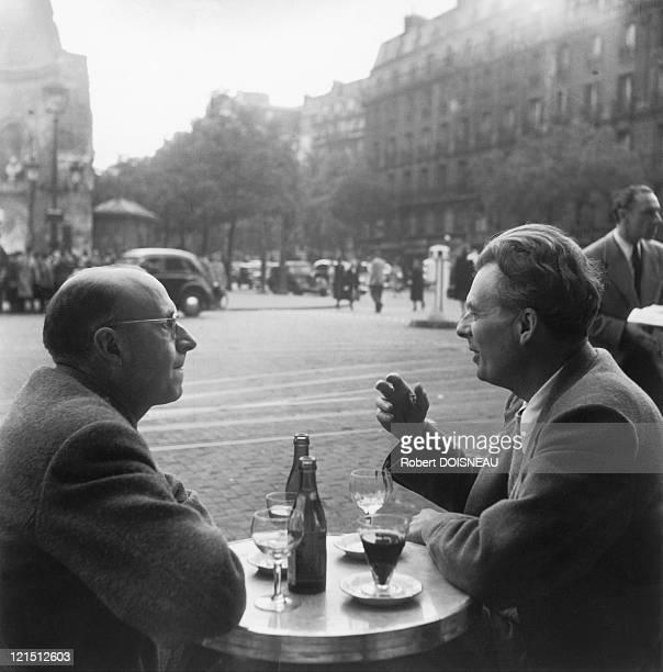 France Paris Pierre Neveu And Aldous Huxley On The Terrace Of Flore Cafe SaintGermainDesPres In 1945
