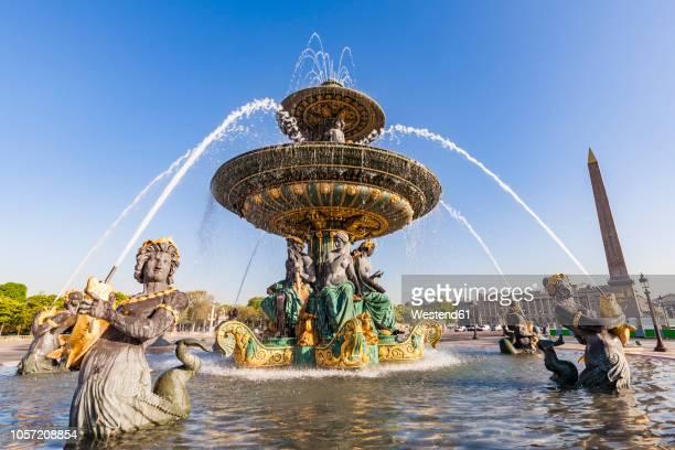france, paris, place de la concorde, fountain and luxor obelisk - fountain stock pictures, royalty-free photos & images