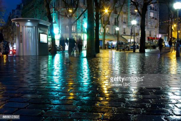 France, Paris, Place des Grandes Rigolles, at night, in the rain.