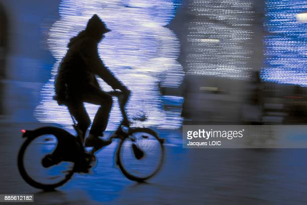 France, Paris, Place dItalie, town hall, Christmas decorations, cyclist silhouette.