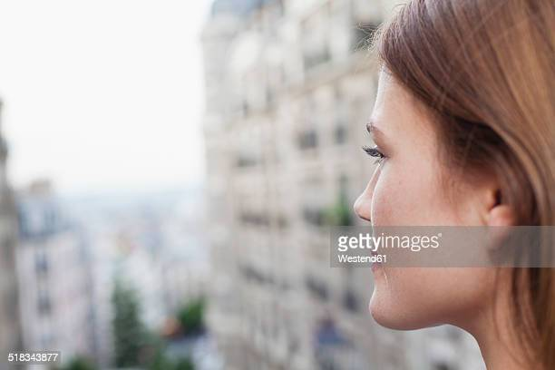 France, Paris, profile of smiling young woman