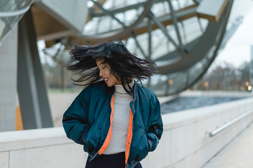 France, Paris, smiling young woman tossing her hair - gettyimageskorea