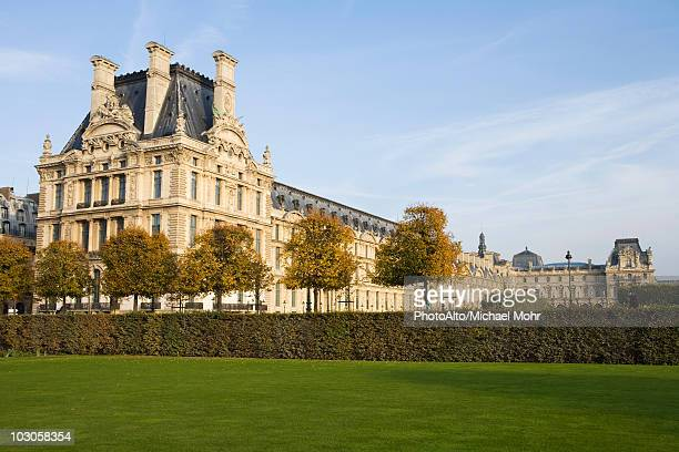 france, paris, the louvre viewed from the jardin des tuileries - louvre stock pictures, royalty-free photos & images