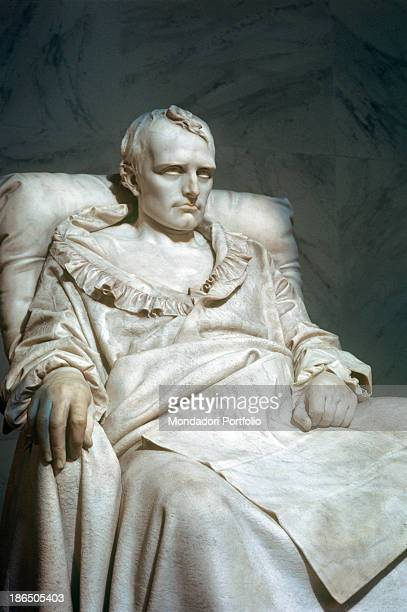 France Paris Versailles Detail Fulllength portrait of Napoleon Bonaparte seated leaning against a large pillow his legs hidden by a draped blanket...