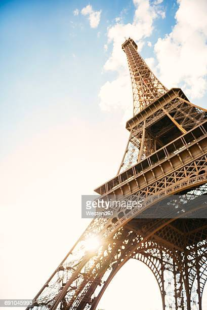 france, paris, view to eiffel tower from below - eiffel tower stock photos and pictures