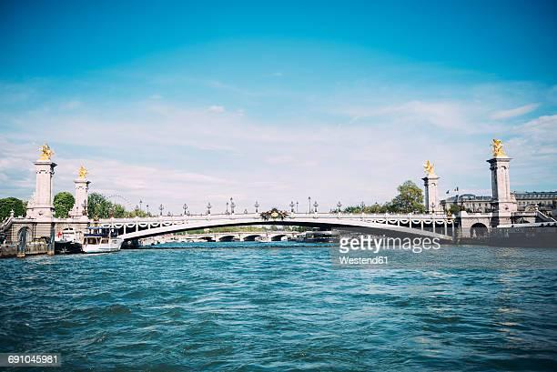 france, paris, view to pont alexandre iii from seine - pont alexandre iii photos et images de collection