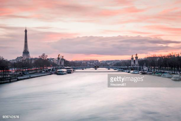 France, Paris, view to Seine River with Pont Alexandre III and the Eiffel Tower in the background at sunset
