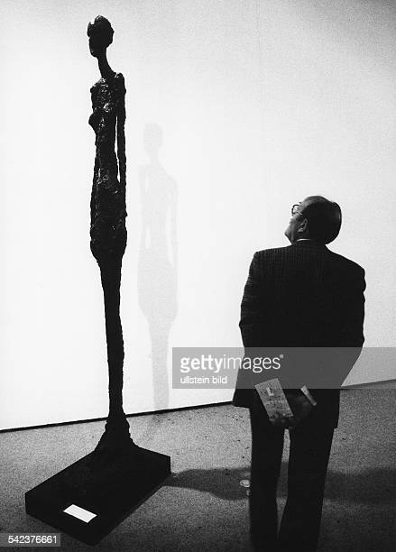 visitors in front of a sculpture by Alberto Giacometti at Centre Pompidou 1978