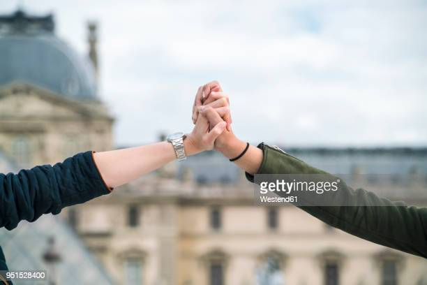 France, Paris, young couple holding hands