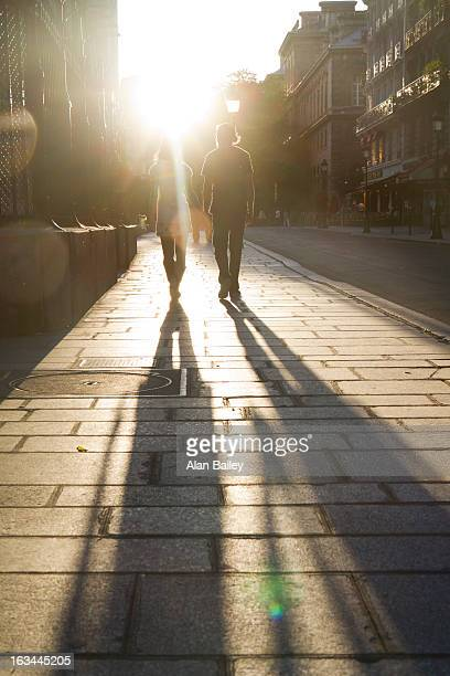 France, Paris, Young couple walking in street