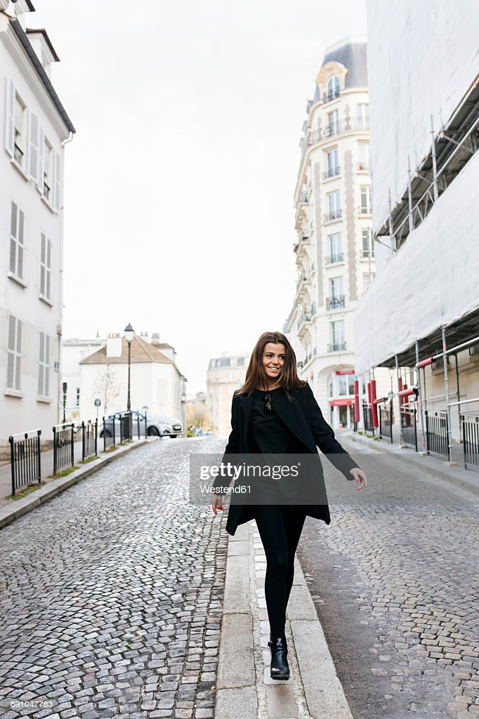 France, Paris, young woman walking on the streets of Montmartre : Stock Photo