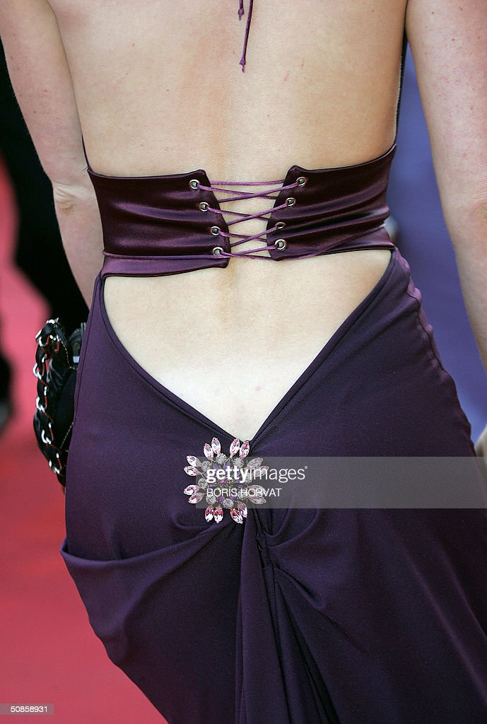Picture shows the detail of a dress worn by an unidentified guest as she arrives for the official screening of the film 'The Motorcycle Diaries', 19 May 2004, at the Cannes Film Festival in the French Riviera town. The film, which is in competition for the festival's coveted top prize, the Palme d'Or, tells the tale of Ernesto 'Che' Guevara and his Cuban traveling companion Alberto Granado's journey across Latin America fifty years ago.