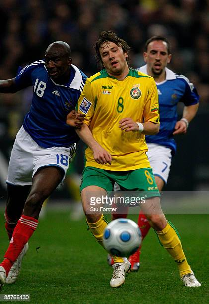 France player Alou Diarra challenges Lithuania player Edgaras Cesnauskis during the group 7 FIFA2010 World Cup Qualifier between France and Lithuania...