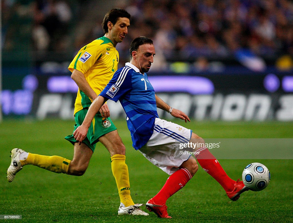 France player Franck Ribery holds off the challenge of Lithuania defender Deividas Semberas during the group 7 FIFA2010 World Cup Qualifier between France and Lithuania at Saint Denis, Stade de France on April 1, 2009 in Paris, France.