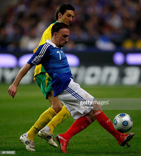 France player Franck Ribery holds off the challenge of Lithuania defender Deividas Semberas during the group 7 FIFA2010 World Cup Qualifier between...