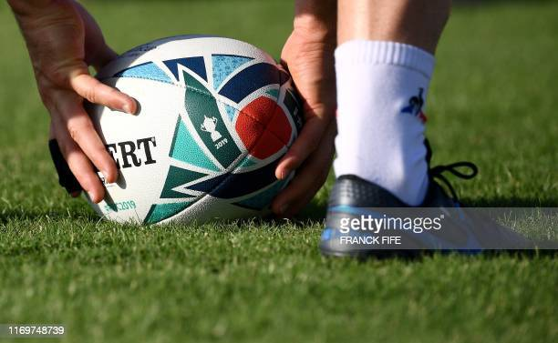 France player handles the ball during a training session at the Fuchu Asahi Park in Tokyo on September 20 ahead of the Japan 2019 Rugby World Cup.
