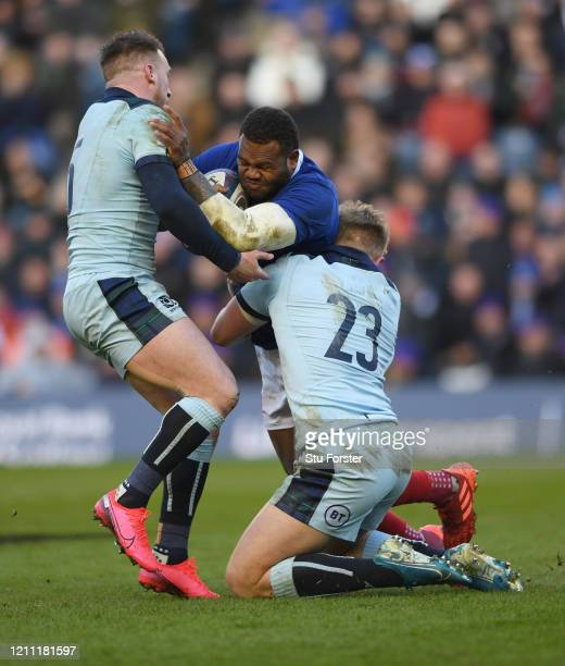 France player Virimi Vakatawa is tackled by Stuart Hogg and Kyle Steyn during the 2020 Guinness Six Nations match between Scotland and France at...