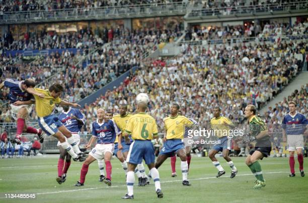 France player Zinedine Zidane scores the first France goal during the 1998 FIFA World Cup Final between France and Brazil at the Stade de France in...