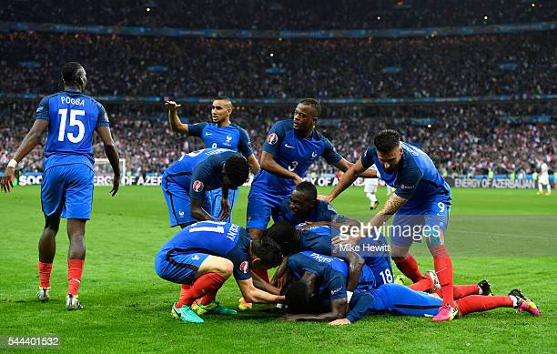 France players celeberate their fourth goal by Antoine Griezmann during the UEFA EURO 2016 quarter final match between France and Iceland at Stade de...