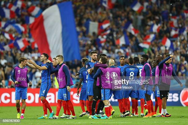 France players celebrate their 2-1 win in the UEFA Euro 2016 Group A match between France and Romania at Stade de France on June 10, 2016 in Paris,...