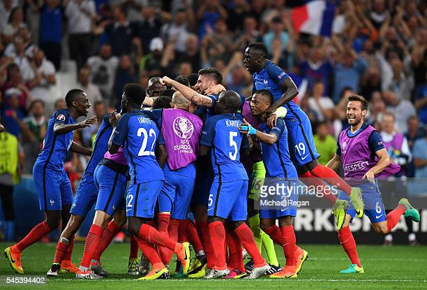 France players celebrate their team's second goal by Antoine Griezmann during the UEFA EURO semi final match between Germany and France at Stade...