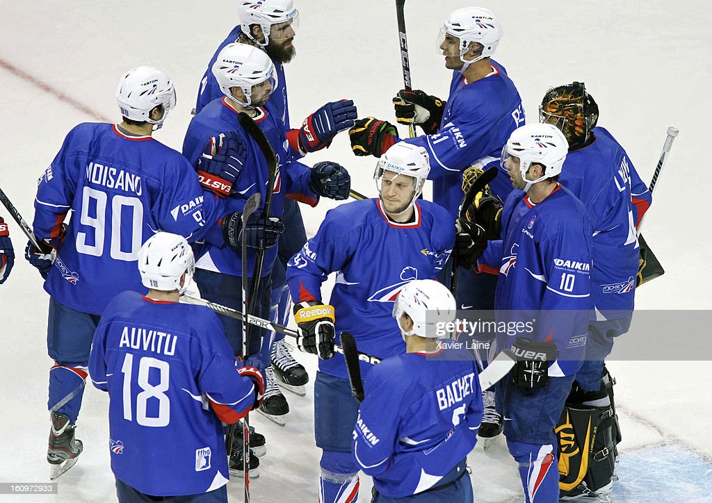 France players celebrate their victory after the Sochi 2014 Olympic Ice Hockey Qualification match between France and Great Britain at Riga Arena on February 8, 2013 in Riga, Latvia.