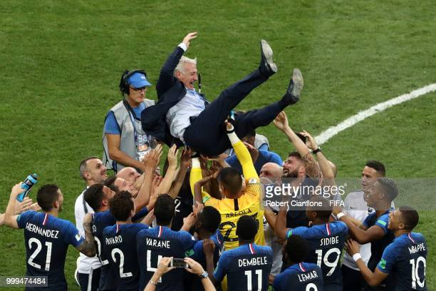 France players celebrate with Didier Deschamps, Manager of France following their sides victory in the 2018 FIFA World Cup Final between France and...