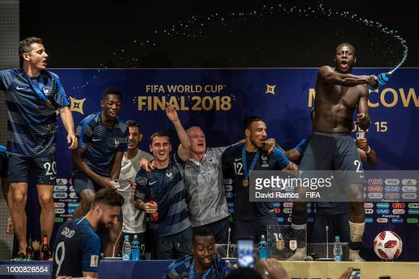 France players celebrate with their manager Didier Deschamps duirng the press conference following their victory in the 2018 FIFA World Cup Russia...