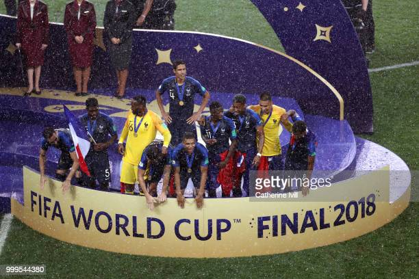 France players gather round after reciveing their Winners Medals ready to be awarded with the World Cup Trophy after the 2018 FIFA World Cup Final...