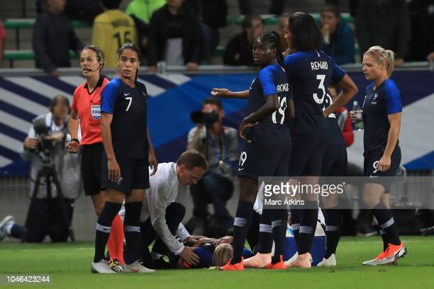 France players react as Amandine Henry of France is treated for a shoulder injury during the friendly match between France Women and Australia Women...