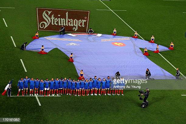 France players stand for the national anthem during the first test match between the New Zealand All Blacks and France at Eden Park on June 8 2013 in...