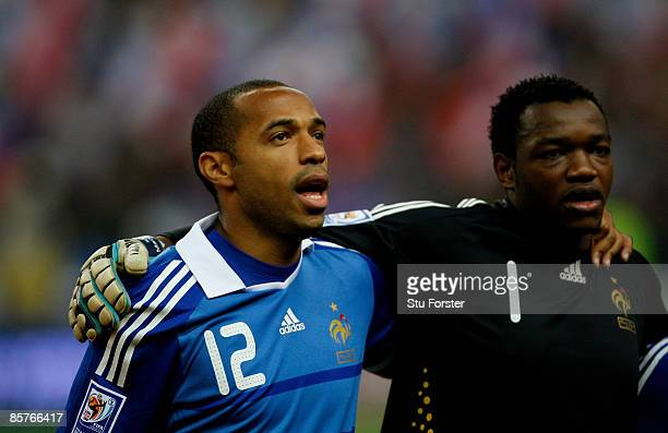 France players Thierry Henry and Steve Mandanda line up before the group 7 FIFA2010 World Cup Qualifier between France and Lithuania at Saint Denis...