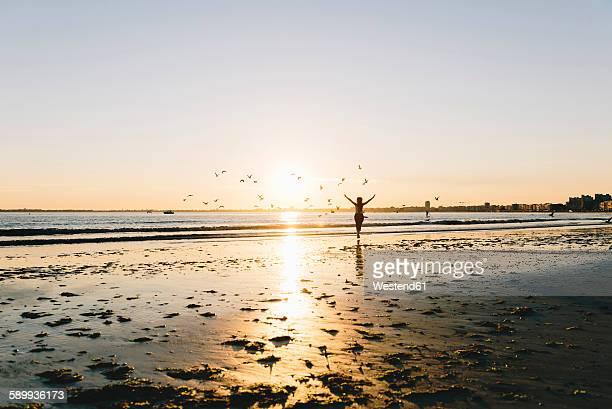 france, pornichet, silhouette of running woman on the beach at sunset - loire atlantique photos et images de collection
