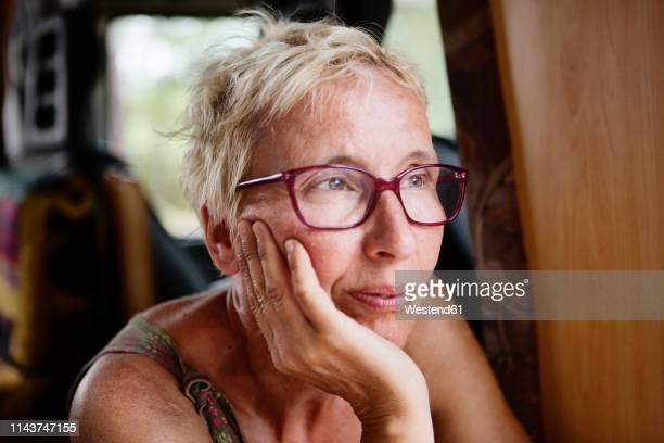 france, portrait of pensive woman in camper - short hair stock pictures, royalty-free photos & images