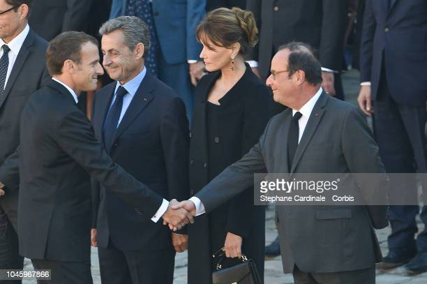 France President Emmanuel Macron shake hands of Francois Hollande next to Nicolas Sarkozy and Carla Brunyduring the national Tribute at Les Invalides...