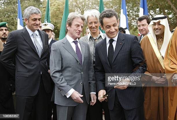 France President Nicolas Sarkozy shows a sword to Foreign Minister Bernard Kouchner and Defence Minister Herve Morin during a visit to the palace of...