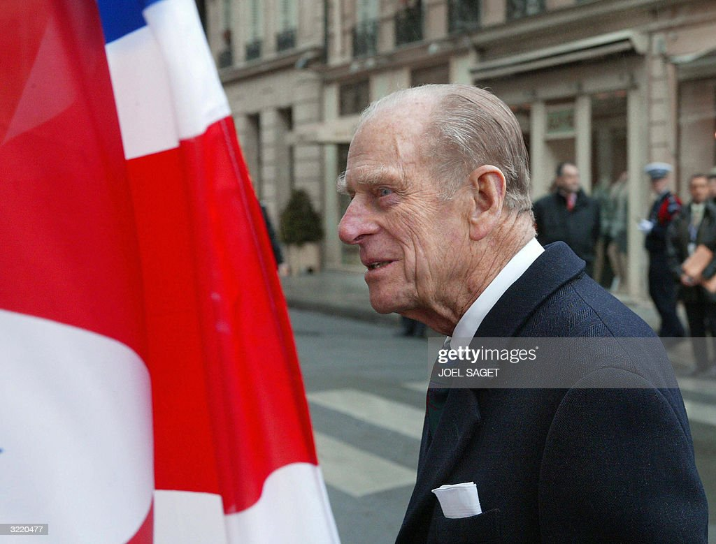 Prince Philip walks from the Elysee Palace to the British Embassy in Paris 05 April 2004, at the start of his wife Queen Elizabeth's three-day state visit to mark the centenary of the Entente Cordiale, the colonial-era promise of cross-channel friendship between Britain and France.