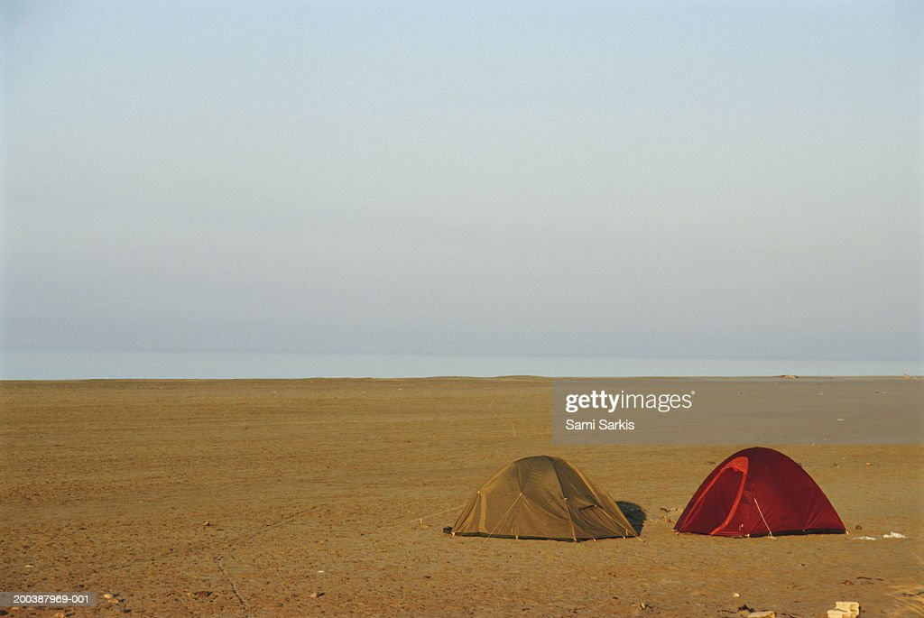 France, Provence, Camargue, two tents on Piemanson beach : Stock Photo