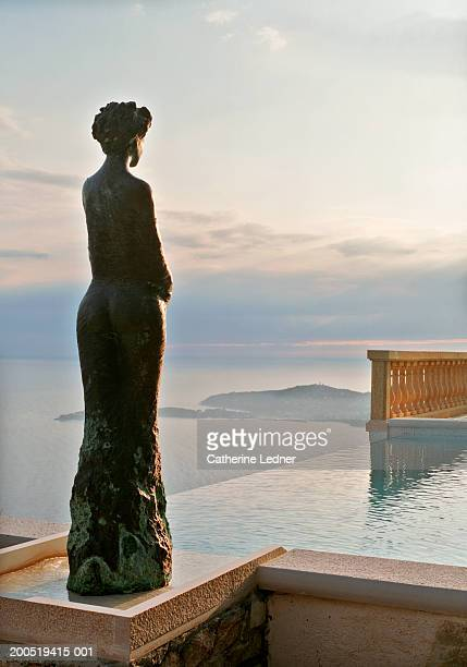 France, Provence, Eze, infinity pool and statue overlooking sea
