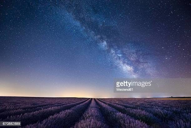 france, provence, lavender fields with milky way at night - horizon over land stock photos and pictures