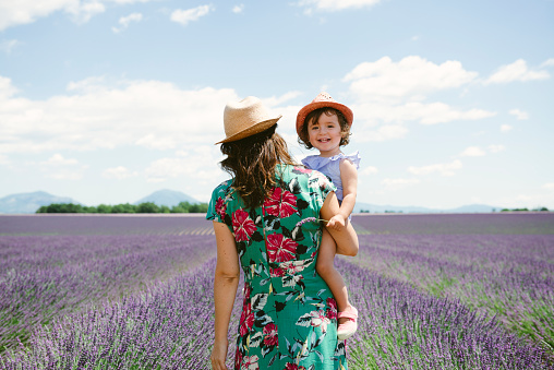 France, Provence, Valensole plateau, Mother and daughter walking among lavender fields in the summer - gettyimageskorea