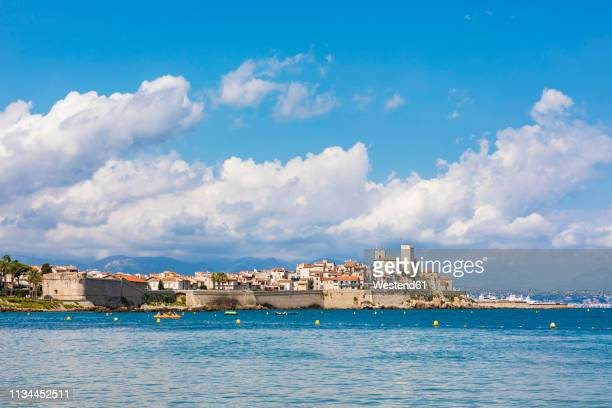 france, provence-alpes-cote d'azur, antibes, old town with chateau grimaldi, city wall - antibes stock photos and pictures