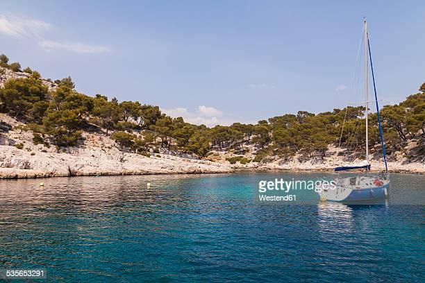 France, Provence-Alpes-Cote dAzur, Bouches-du-Rhone, Calanque near Cassis, Sailing boat, Mediterranean Sea