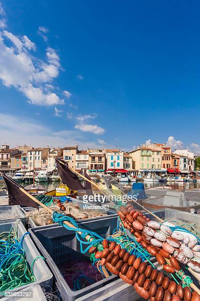 france, provence-alpes-cote d'azur, bouches-du-rhone, cassis, fishing nets at harbour - cassis stock pictures, royalty-free photos & images