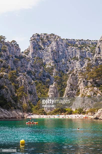 france, provence-alpes-cote d'azur, bouches-du-rhone, mediterranean sea, calanque d'en-vau near cassis, les calanques, beach and canoe - cassis stock pictures, royalty-free photos & images